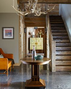 Lovely proportions, warm natural colors and textures and some beautiful furniture.  A great entrance.