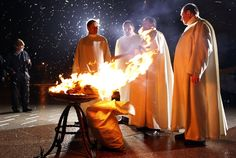 The Priest lights the fire before Vigil