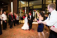 Have your guests throw rose petals as you exit. Casey and Greg's Vino Inspired Wedding at the Marriott Long Wharf in Boston » Fucci's Photos of Boston | Boston Wedding Photographer
