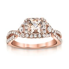 Morganite and Diamond Ring  Sweet peach Morganite wrapped in diamonds and rose gold.  Perfect treat for any ring finger.  Makes a luscious alternative engagement ring too!  Matching bands available. (scheduled via http://www.tailwindapp.com?utm_source=pinterest&utm_medium=twpin&utm_content=post60549102&utm_campaign=scheduler_attribution)