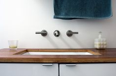 plywood countertops and wall mount faucet
