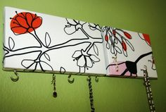 I've been searching for the perfect DIY key rack...this is it! (Not the fabric, but the idea)