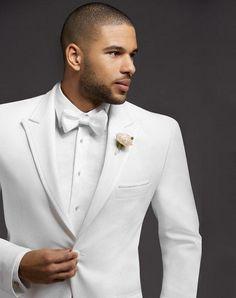Two-Button Satin-Edge Peak Lapel in White | The Men's Wearhouse® | https://www.theknot.com/fashion/1890-pronto-uomo-tuxedo