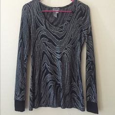 Shimmery long sleeve dressy top Super cute with skinny jeans! Thinner material so perfect for spring nights. Shimmery black and silver. Size small BKE top. BKE Tops Blouses