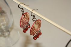 Make your own earings out of scrap book paper!