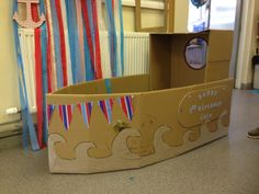 Child's cardboard boat, sailor theme, kids party boat, play area.