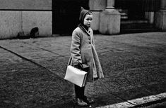 """Diane Arbus, """"Girl with a pointy hood and white schoolbag at the curb, N."""" (courtesy The Metropolitan Museum of Art, New York; copyright © The Estate of Diane Arbus, LLC; all rights reserved) Diane Arbus, August Sander, Vivian Maier, Richard Avedon, Coney Island, White Photography, Street Photography, Photography Gallery, Film Photography"""