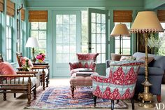 The sun room is painted in Farrow & Ball's Folly Green | archdigest.com