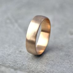 Wide Men's Gold Wedding Band. Recycled 10k Yellow Gold 6mm. Brushed Low Dome Man's Gold Wedding Ring. Size 9.5 or Made in Your Size. $480.00, via Etsy.