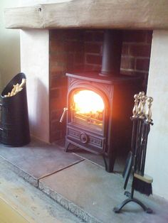 Wood burning stove~ into the fire place Wood Burner Fireplace, Fireplace Hearth, Fireplaces, Oak Mantle, Fireplace Ideas, Wooden Fireplace, Cottage Fireplace, Inglenook Fireplace, Mantel Ideas