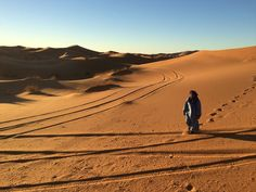 Taken on November 26, 2016. While in Morocco, I decided to take a trip into the western Sahara Desert. I snapped this picture on our way back to the Berber village after spending a night in the open Sahara Desert. We rode camels for two hours, stopping once to take pictures as the sun rose. The man pictured here was my Berber guide who calls the desert his home.Photo by Hailey Zirkle