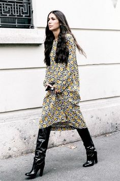 A floral dress is worn with patent leather boots