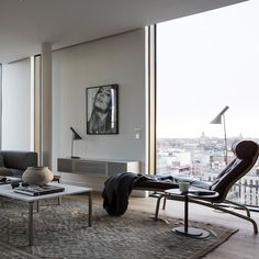What a view! AJ floor and table lamps by Arne Jacobsen from Louis Poulsen via @eklundstockholmnewyork #LouisPoulsen #homedesigninspiration #lighting #home #interiors #howyouhome #homeideas #homebeautiful #housebeautiful #homestyle #livingroom #decor #decorate #homedeco #housedecor #decorating #moderndecor #homedecor #homedecoration #interiordecor #interiorstyling #homedecoration #housedecor #lightinginspo #roominspo #interiorinspo #homeinspo