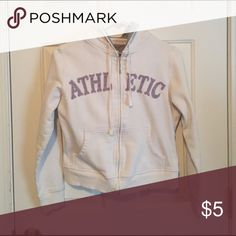 Sweatshirt with hoodie White sweatshirt with hoodie. With two pockets in zipper .Says athletic in gray with purple outline size Junior medium lifo Sweaters