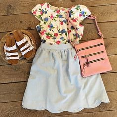 cream, blue, pink, and green floral blouse and light blue scalloped skirt