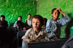 Where the children should be - in school. It doesn't need the latest computers - just knowledge/learning. Bamiyan Afghanistan