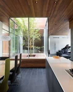 grey floor w/cherry-warm wood tones and white countertops: just a tiny court yard :)
