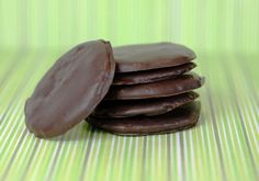 Homemade Paleo Thin Mints are as easy as 1-2-3. Healthy copycat Girl Scout Cookie recipe that's low-carb with dark chocolate, almond flour, and cacao.