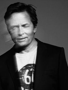 Michael J. Fox... a shot in slow shutter speed reveals Parkinson movements. A photograph that tells a sad story. <3