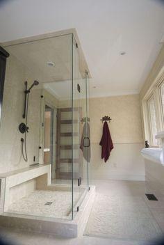 Custom bathroom with glass shower, pebble tile floor and built in bench seat. Built by Ferguson Fine Homes. www.fergusonfinehomes.com
