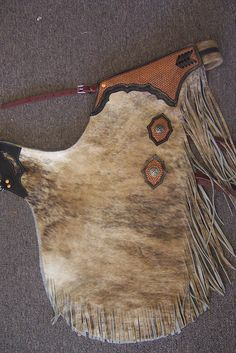I could use a new pair of chaps. Leather Art, Saddle Leather, Leather Tooling, Tooled Leather, Cowboy Gear, Cowboy And Cowgirl, Western Wear, Western Chinks, Horse Accessories