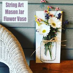 This mason jar string art vase is our new obsession. I have a confession to make. Mason jars are my addiction. I can't NOT buy them at a garage sale. Diy Hanging Shelves, Floating Shelves Diy, Glass Shelves, Mason Jar Flowers, Flower Vases, Diy Flowers, Mason Jar Crafts, Mason Jar Diy, Mason Jar Dispenser