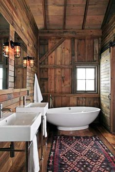 Clean-lined fixtures keep the master bath from feeling like a cigar box. | Photo: James Yochum