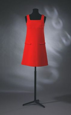 Mini-dress   André Courrèges   V&A Search the Collections: This is a super mod dress made by André Courrèges. It was made in Paris in 1966 and is made of wool gabardine and lined with silk. The pockets at the front are false and the dress has an a-line silhouette with a low square-cut neckline.