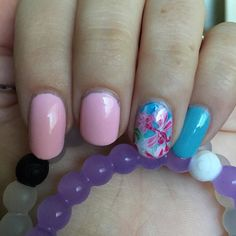 Using my new #miraclemat and I love it!  #nailart #nailstamp #naildesign #nailpolish #nail #accentnail #accentnails #floralnails #flowernails #pinknails #bluenails #ombrenails #gradientnails #reversestamping #reversenailstamping #lokaibracelet #lokai #lokaipurple #purplelokaibracelet #originallokai #sallyhansennailpolish #sallyhansen #tickledpink #bigteal by coleyb91