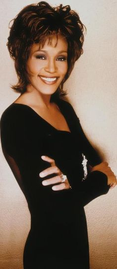 Whitney Elizabeth Houston wearing Marc :Bouwer couture black jersey dress with zipperfront
