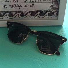 AUTHENTIC CLUBMASTER RAY BANS Tortoise shell coloring on rim, gold outer rim. Condition is very good! Ray-Ban Accessories Sunglasses