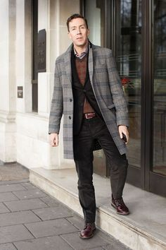 Wearing a bespoke suit, Isaia jumper and Paul Smith boots.