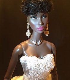Customer's doll wearing silver, crystal and pearl doll jewelry by Mini Luxe Collection. The lighting makes her look like she's out at night at a party or ball.