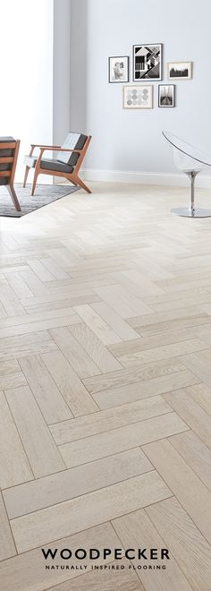 Whitened Oak Wander barefoot along the pale, rolling tones of this graceful parquet floor. Get a free sample at our website.Wander barefoot along the pale, rolling tones of this graceful parquet floor. Get a free sample at our website. Living Room Flooring, Kitchen Flooring, Interior Design Living Room, Oak Parquet Flooring, Wooden Flooring, Herringbone Floors, Herringbone Pattern, Floor Design, House Design