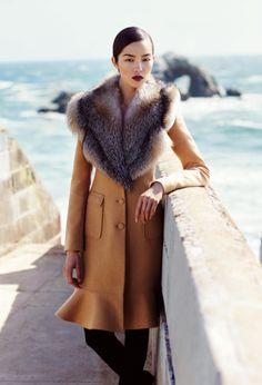Wool Cooper coat with golden island fox fur collar in caramel. $5770.