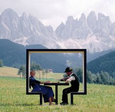 Love the contrast of the bench/table, the 'trachten' clothes and the mountains (dolomites?) in the back ground