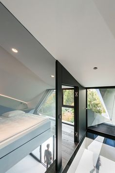 Image 25 of 35 from gallery of CoMED / architekten ZT KG. Photograph by Hertha Hurnaus Photography Architecture Origami, Architecture Cool, Contemporary Architecture, Contemporary Homes, Living Room Decor, Living Spaces, Living Rooms, Modern Master Bedroom, Compact Living