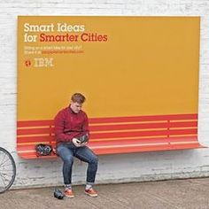 "IBM's ""People For Smarter Cities"" ads double as benches, ramps and shelter from the rain.    The project aims to encourage 'smarter thinking' when it comes to coming up with solutions for the city. The ads also encourage people to share their ideas on how they can improve their neighborhood."