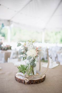 boells will be boys:: Table decor of burlap, antlers, succulents and coral, ivory and mint.
