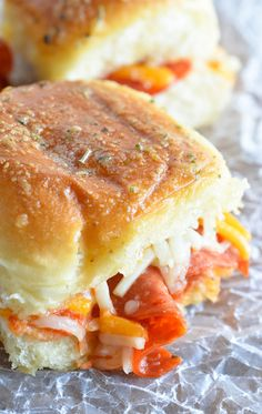 These Oven Baked Pepperoni Pizza Sandwiches are the perfect game day recipe! Quick, easy and guaranteed to be a crowd favorite!!