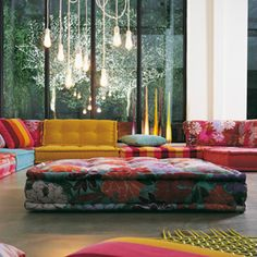 Bright eclectic Maj Jong secular sofa. Love the exposed bulbs and general modern boho vibe of this living space.