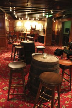 speakeasy seating...wine barrels for tables! How's that for rustic? Note: no tablecloths.