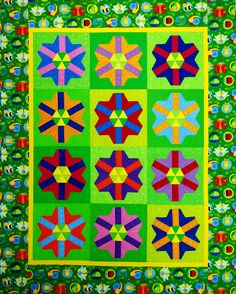 """""""Blooming Hexagons"""" from C&T Publishing's book """"Flip & Fuse Quilts"""" by Marcia Harmening of Happy Stash Quilts"""