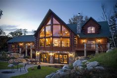 By Golden Eagle Log Homes (Wisconsin).  Love the prow!  Gorgeous.