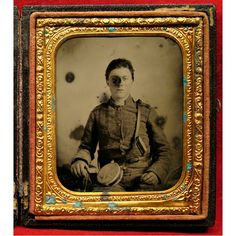 "A 6th Plate Ruby Ambrotype of a Confederate Infantryman. Remarkable content and clarity. Unfortunately there is some spotting and a couple of small marks on our subject's face. He is carrying a flat faced tin drum canteen marked ""AKM"" and a large bone handled ""D"" Guard Bowie Knife in his belt. (Continued in comments.)"