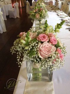 Top Table Flower displays. Little posies made of gypsophila, pale pink roses, antihrinum, pink spray roses and ammi.