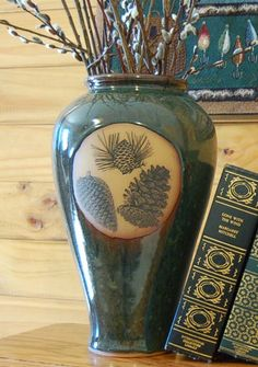 Thank you. You will receive a $1 off coupon during checkout. Forest Green Colored Slender Vase With Pine Cones
