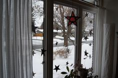 A window full of Origami stars.  I used the tutorial pinned in my Swedish Christmas board. When Christmas was promising to be white!