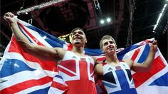 Louis Smith and Max Whitlock of Great Britain celebrate with a Union Flag during the Artistic Gymnastics Men's Pommel Horse Final on Day 9 of the London 2012 Olympic Games at North Greenwich Arena