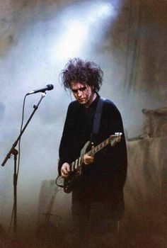 Robert Smith - singer and guitarist for the Cure, an enduring English band that bridged the gap between punk and goth.